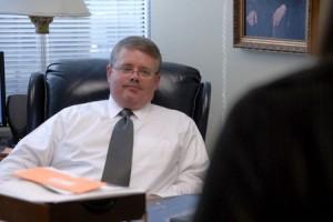 Photo of attorney David Guin at his desk