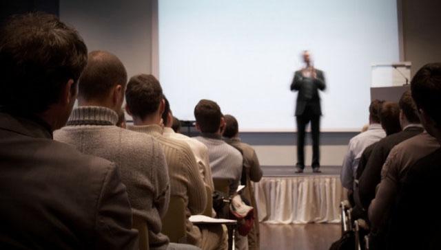 Image of speaker on stage