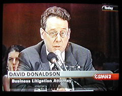 Image of attorney speaking before U.S. Senate Banking Committee